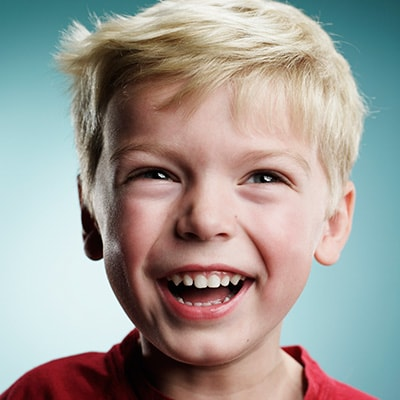 Close up of a young boy laughing